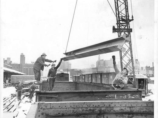 Iron workers erecting steel on the Rochester War Memorial, 1953