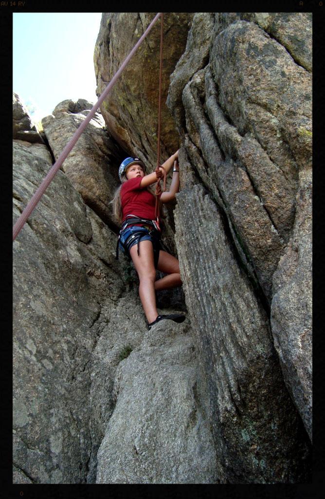 Knights of Heroes girls program camper climbing.