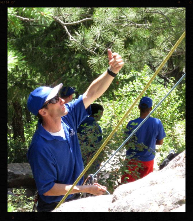 Steve belaying a camper.