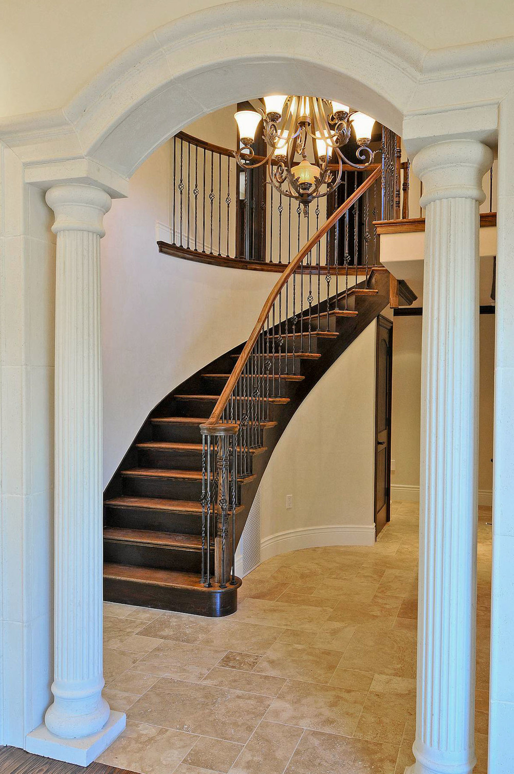 Classic Columned Entry with Curved Grand Staircase