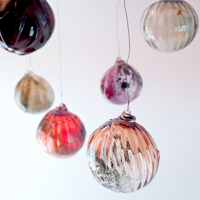 crooked xmas glass balls with iron and copper oxides