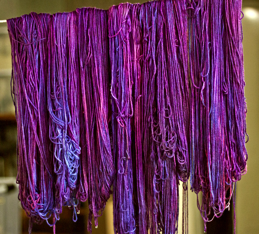Skeins of Norwegian Elkhound In Running Dog Nebula drying after being dyed.