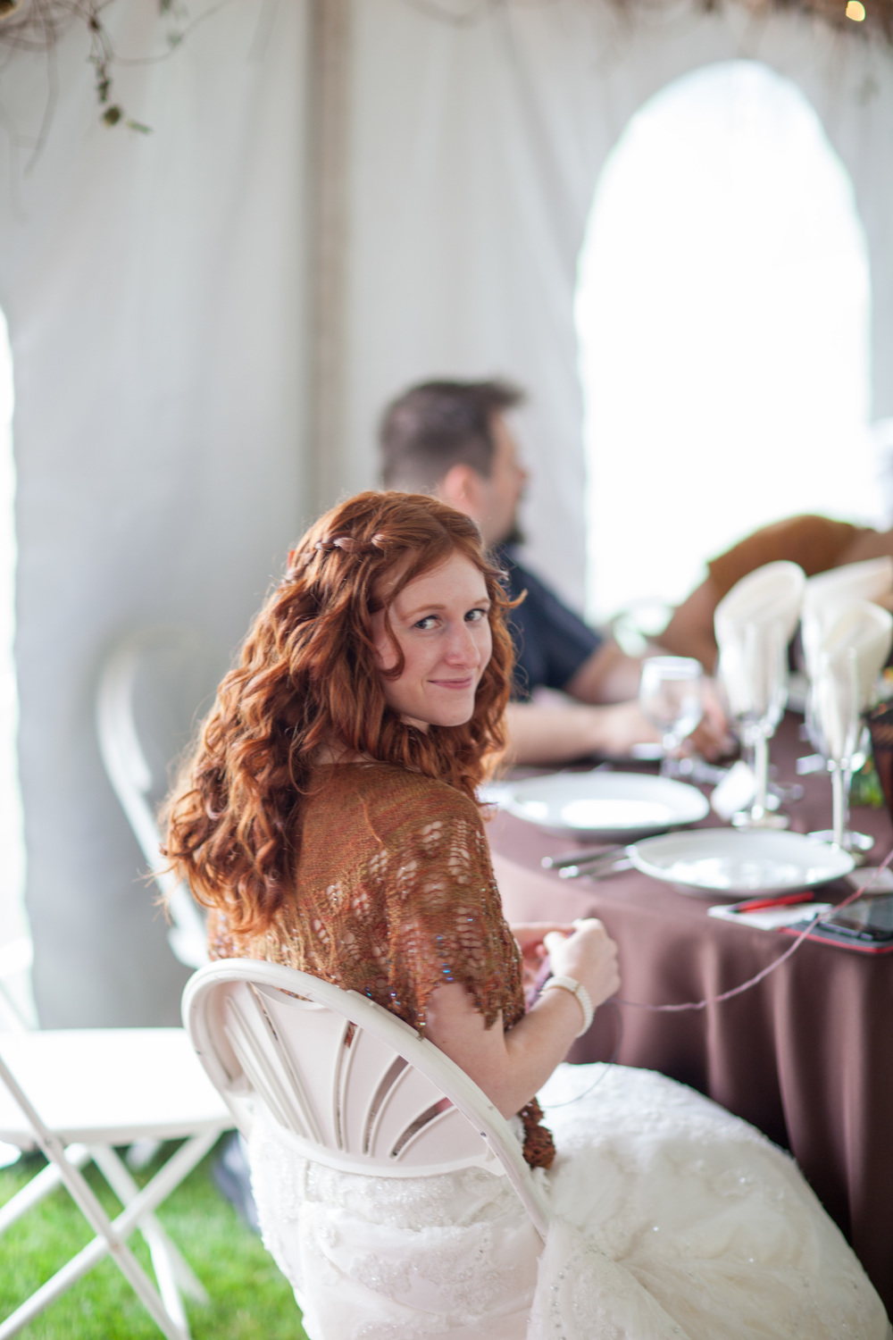 Of course I'm knitting at my reception. Copyright OMG Photography