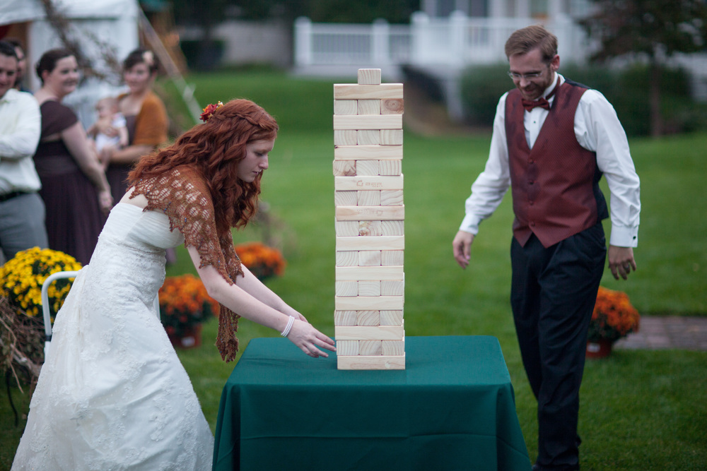 We also had giant Jenga.  (I won.)  Copyright OMG Photography