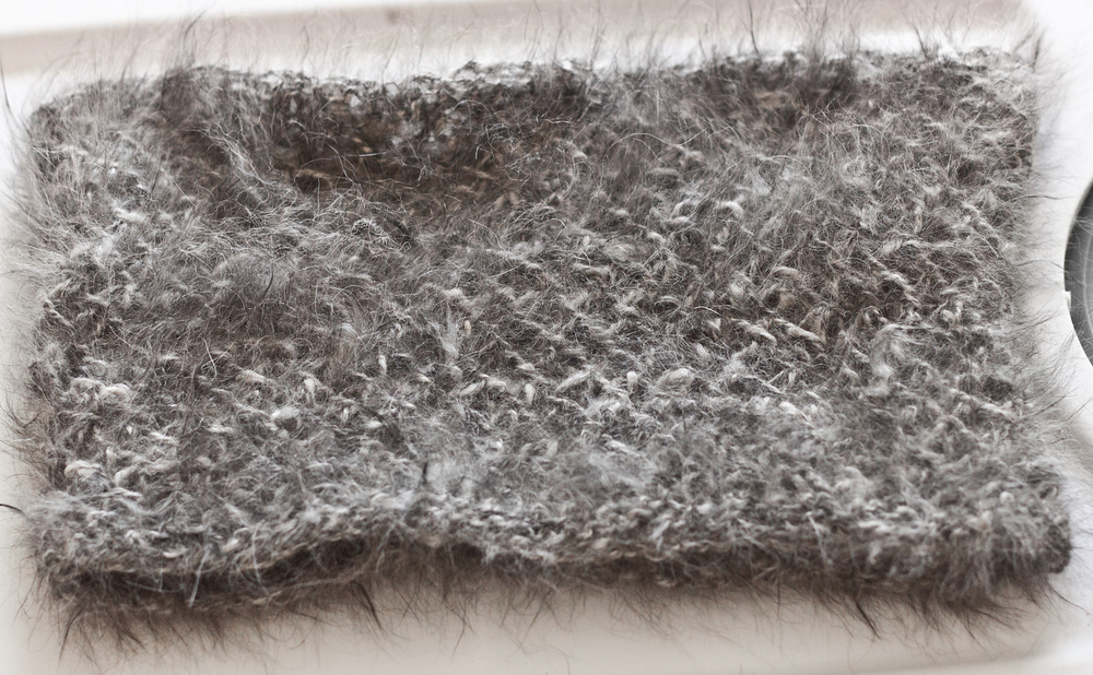 A cowl made out of fluffy handspun angora rabbit