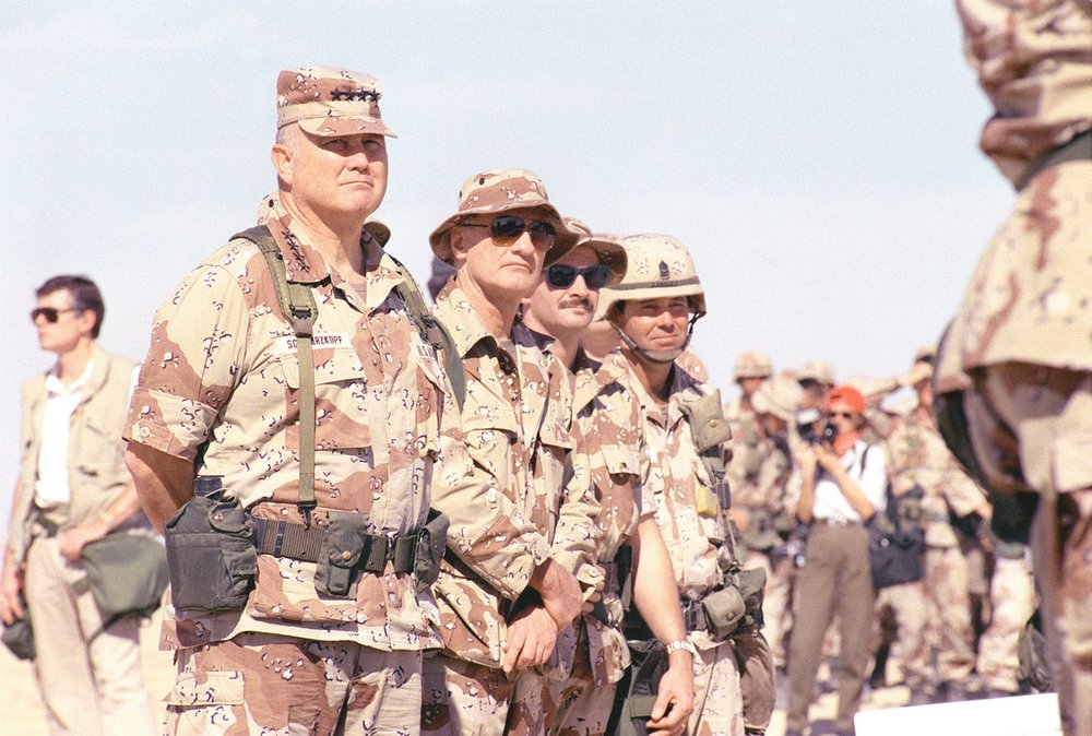 U.S. Army Gen. H. Norman Schwarzkopf (left), U.S. Central Command commander-in-chief, inspects troops while visiting a base camp during Operation Desert Storm in Saudi Arabia, April 5, 1991.