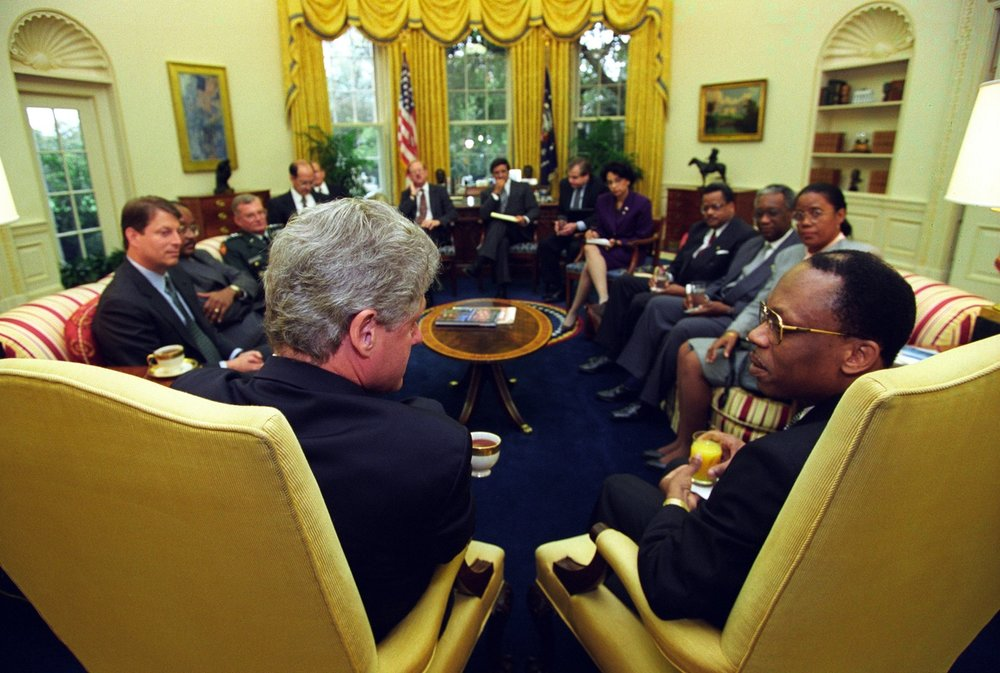 President Clinton meets with President Jean-Bertrand Aristide of Haiti in the Oval Office on October 14, 1994 (Clinton Presidential Library)