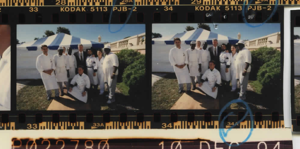 President Clinton with catering staff at Summit of the Americas on December 10, 1994 (Photo sheet: P022780)
