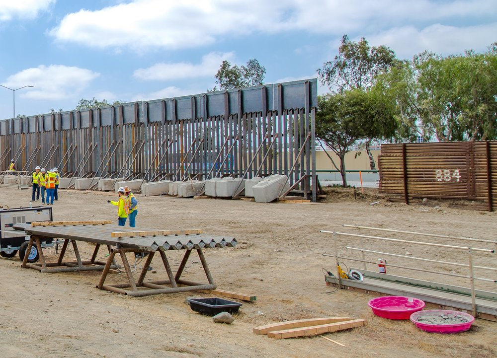 "Caption by CBP: ""Construction workers putting up new wall at the border located at the Chula Vista Area of Responsibility, California, on June 19, 2018. Seen here is new and old wall to the East."""