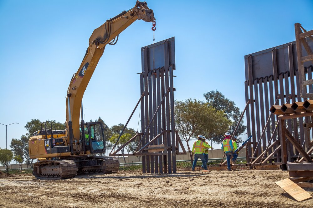 "Caption from CBP: ""Construction workers putting up new wall at the border located at the Chula Vista Area of Responsibility, California, on June 19, 2018. Seen here is the placement of a new border wall panel."""