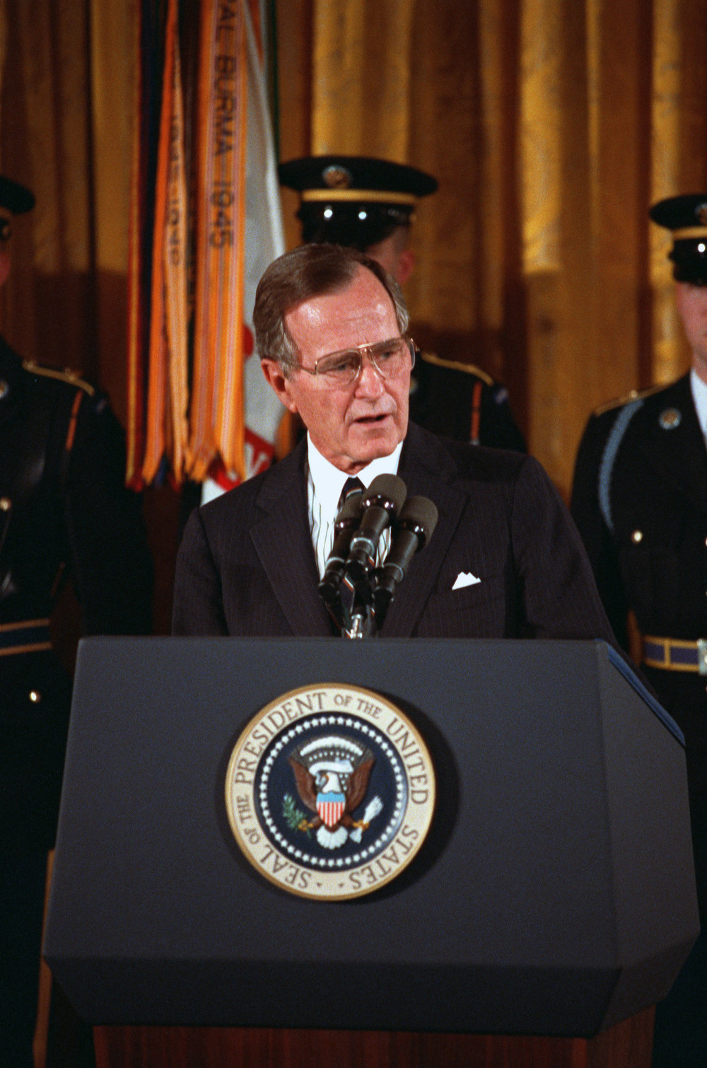 President George H. W. Bush presented a posthumous Medal of Honor to the sisters of Army Cpl. Freddie Stowers, a native of Anderson County, S.C., for action during World War I at the White House in Washington, D.C., April 4, 1991. Stowers displayed exceptional heroism on Sept. 28, 1918, as a squad leader in Company C, 371st Infantry Regiment, 93rd Infantry Division. His unit devastated by the enemy, with bold personal bravery and leadership he took charge, inspired his men to follow him into the fray, taking out a machine gun nest. Fatally wounded by gunfire, with his inspiration, Company C pressed its attack against incredible odds, aiding in the capture of Hill 188, causing heavy enemy casualties. Stowers is the only Black American to receive the medal for action during World War I. (DoD photo by Robert Ward)