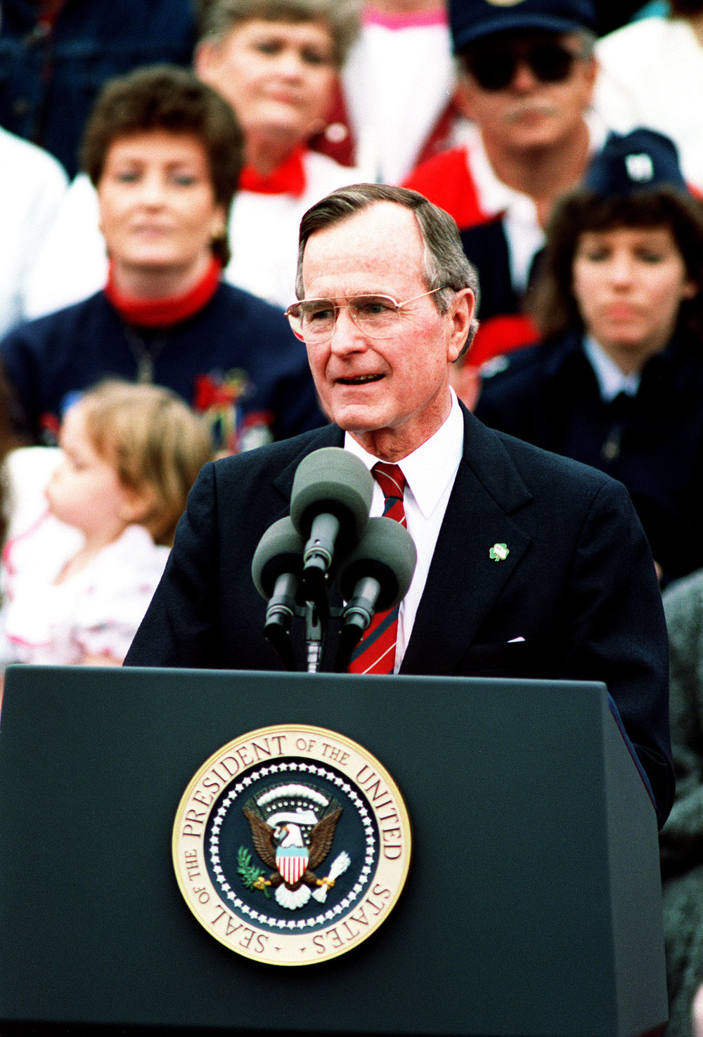 President George H.W. Bush speaks during a welcoming ceremony for U.S. military personnel just returned from deployment in Saudi Arabia during Operation Desert Storm at Sumter, S.C., March 24, 1991. (Photo by N. Miller)