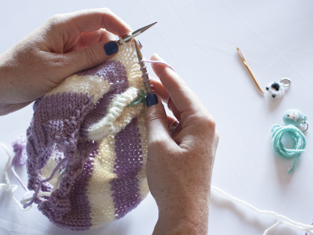 Continue knitting around the row