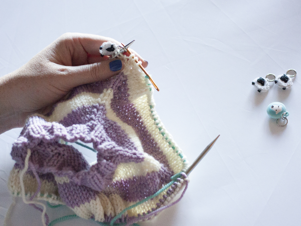Move the sleeve stitches to a holder