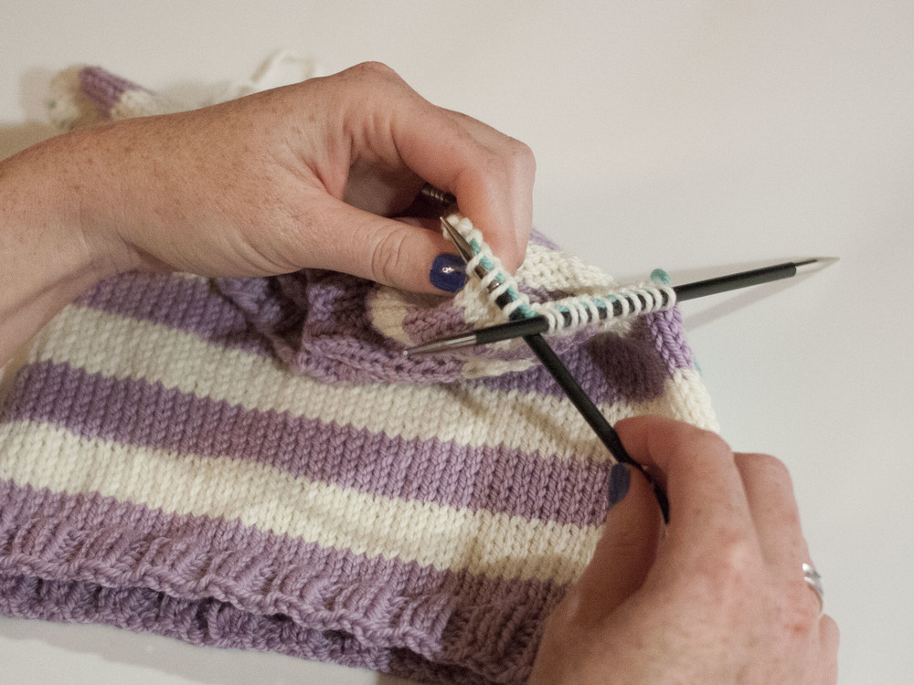 Putting stitches on double-pointed needles