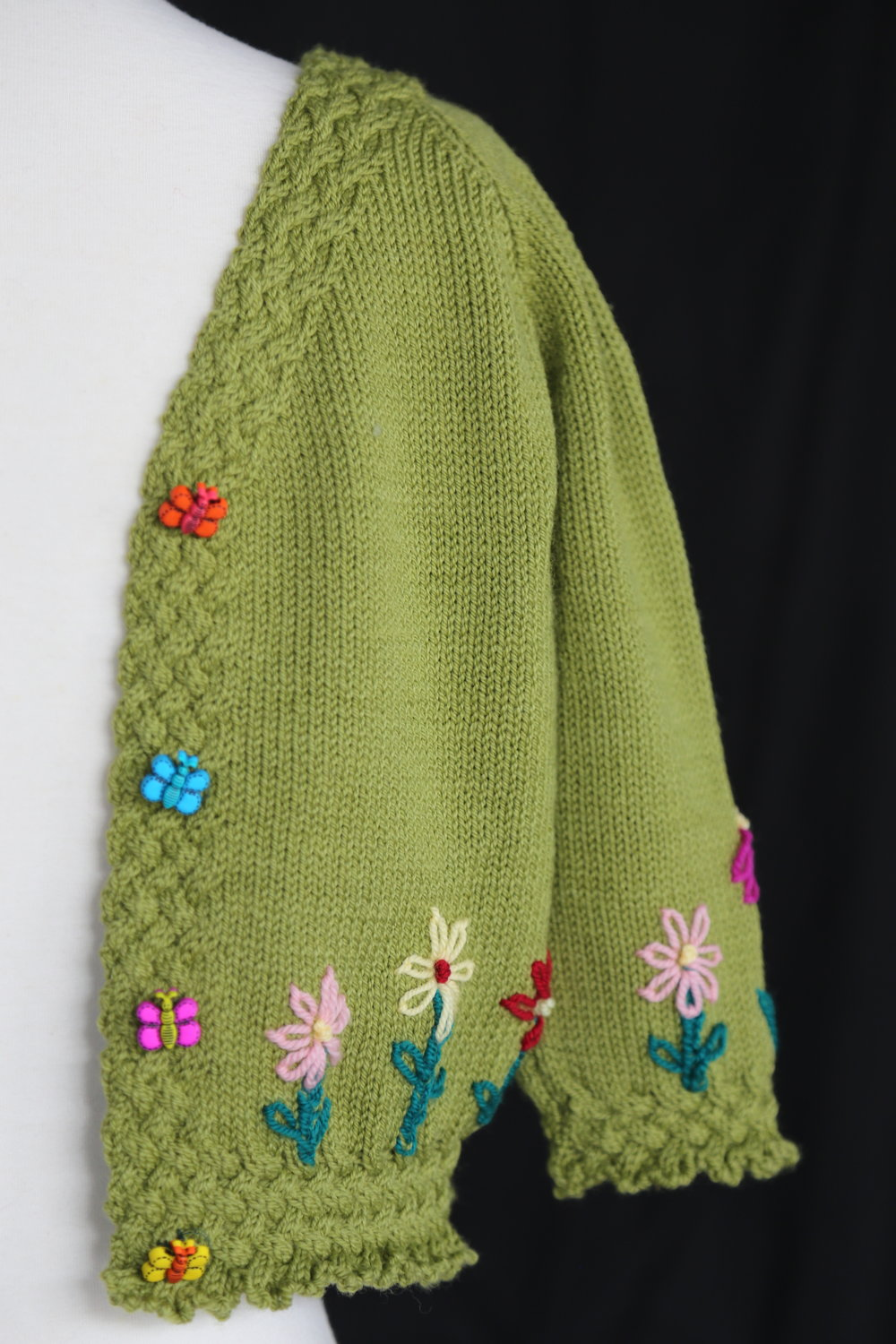 A Basket Full of Posies sweater by Katharine Seaman of TKGA.