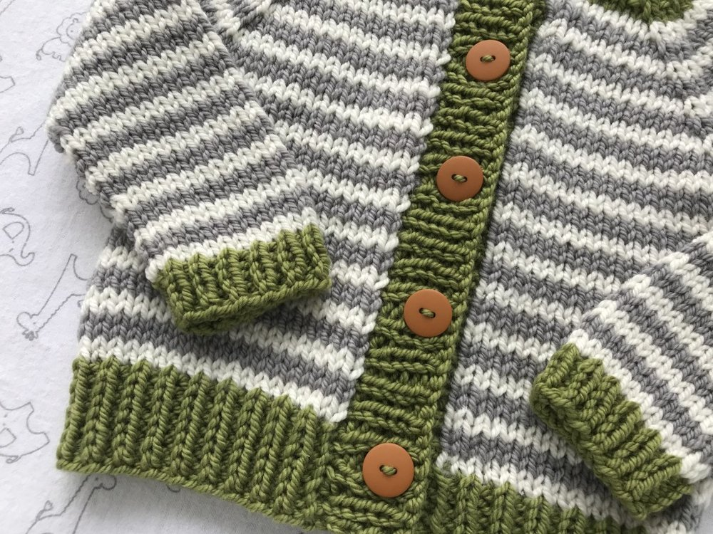 Close up of Little Coffee Bean Bulky baby sweater knitting pattern in Ewe Ewe Baa Baa Bulky yarn