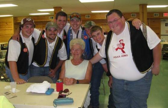 """A local polka fan with Matthew Matous, Jerry Petter, Kaleb Trojacek, Matt Zajic, Zachary Matous and Joshua """"TubaTex"""" Goodwin."""