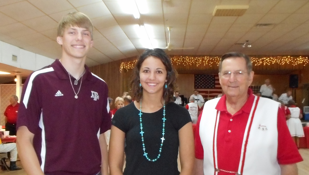 2014 PoLK of A Scholarship Winners Cody Janak and Kendall Kristynik with Scholarship Chair James Freytag. The scholarships were awarded at the Klub's meeting on Sunday, July 13, at the American Legion Hall in Sealy.   See more photos  from the event.