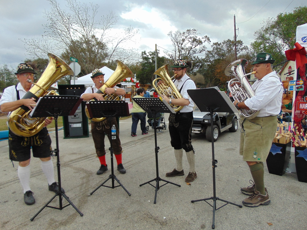 TubaMeisters can set up anywhere, like this street at last year's Tomball German Christmas Market. (L-R) Al Tapia, Ray Grim, Ezra Johnson, Richard Wallace./Julie Matus photo