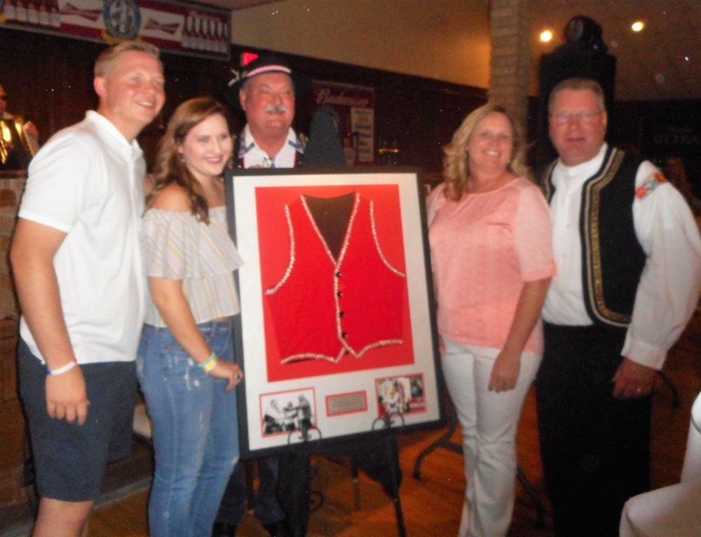 DZ, surrounded by family, was honored at 2016 National Polka Festival for serving as director. Former Ennis mayor Russell Thomas presented DZ with a framed vest that belonged to his dad.