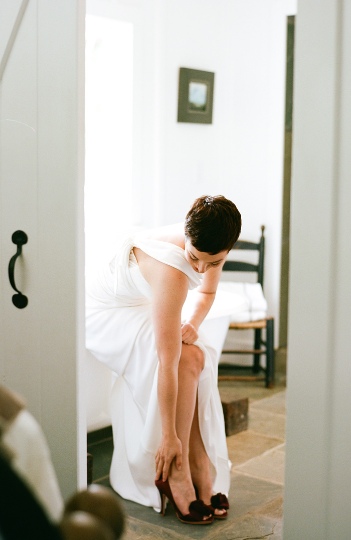 The pixy-cut bride puts on her purple shoes and gets ready for her big day.
