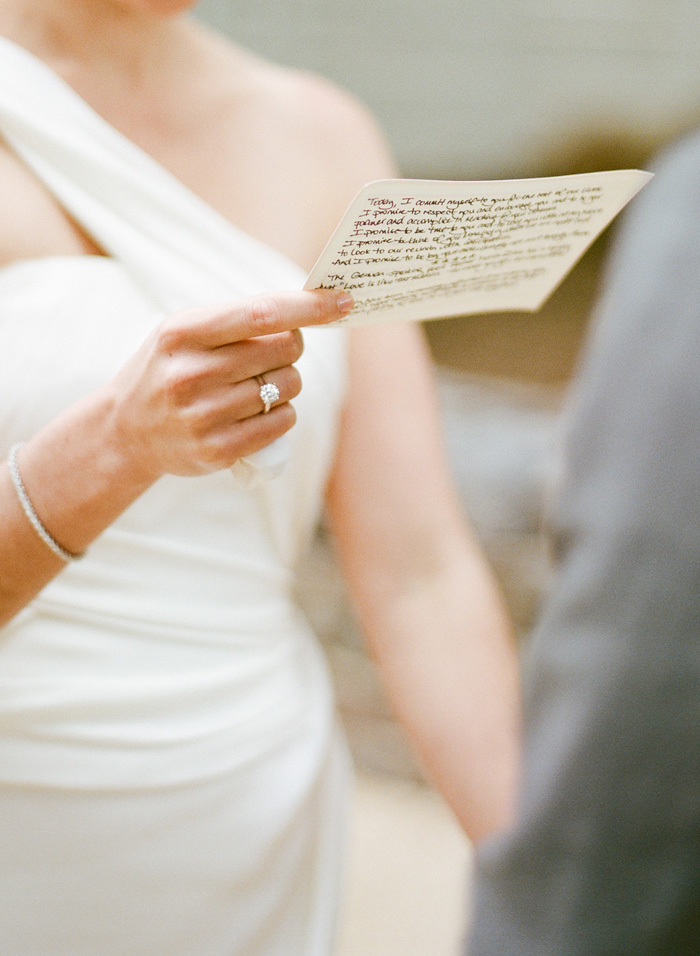The bride wrote her own vows and recited them to her soon-to-be husband in front of all of their family and friends.