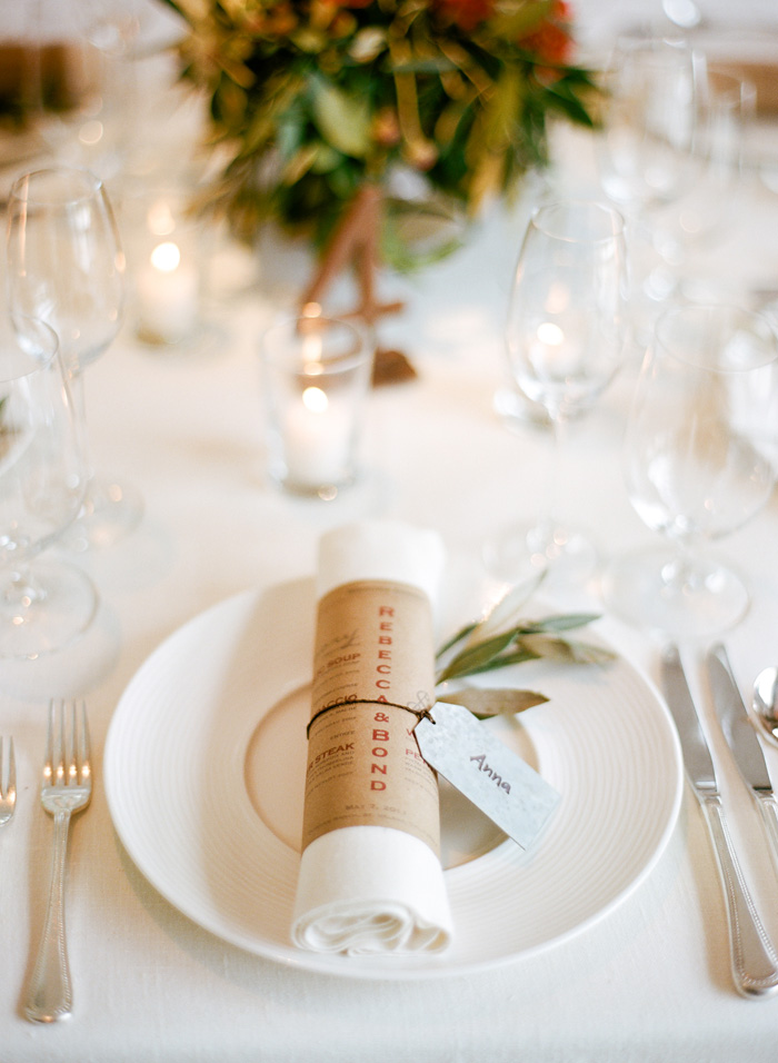 Each place setting had a napkin beautifully wrapped in the dinner menu and tied together with a custom name-tag.
