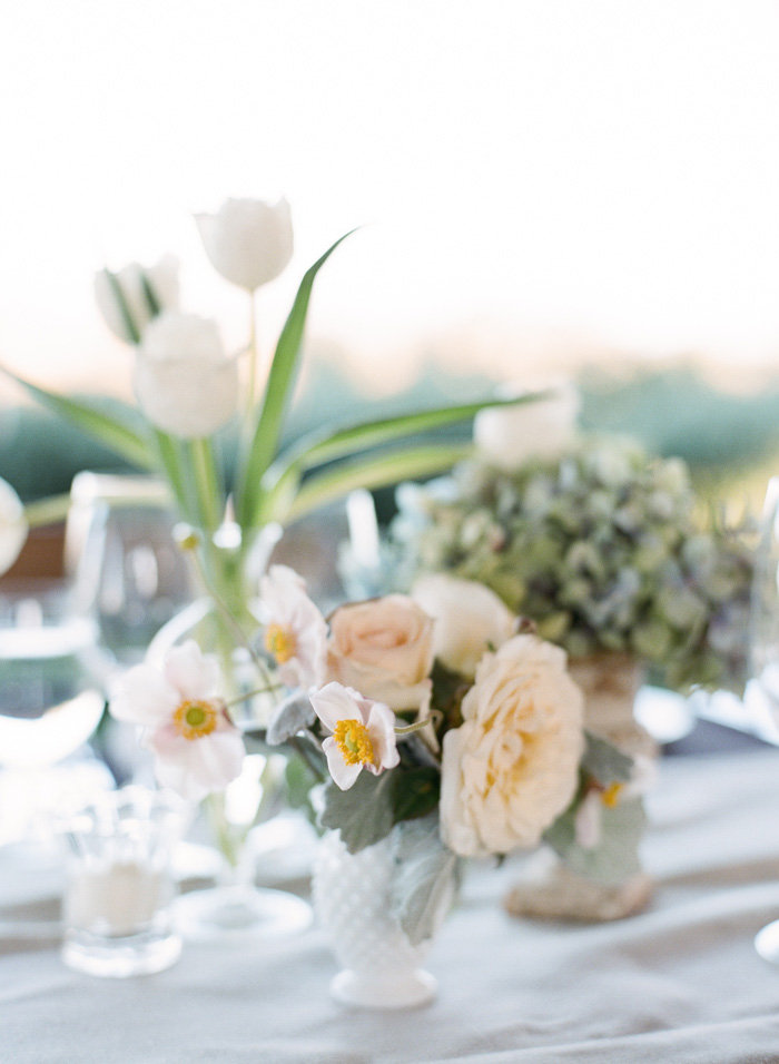 Peach flowers and pink flowers with yellow centers decorated every table.