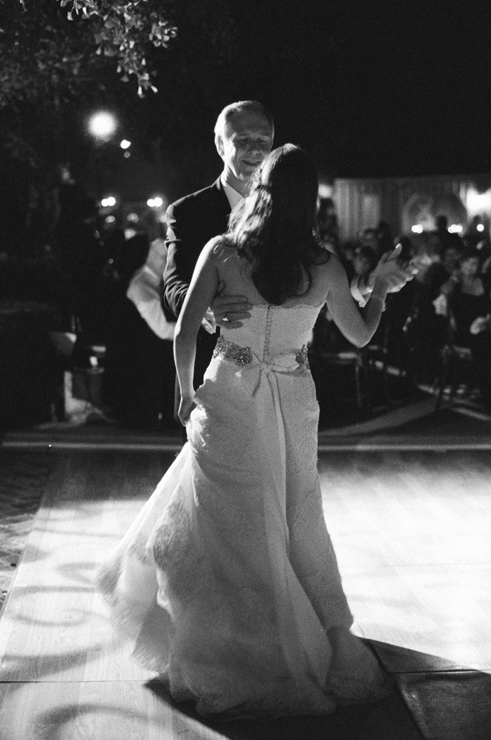 As the bride does her father-daughter dance with her dad, it's easy to