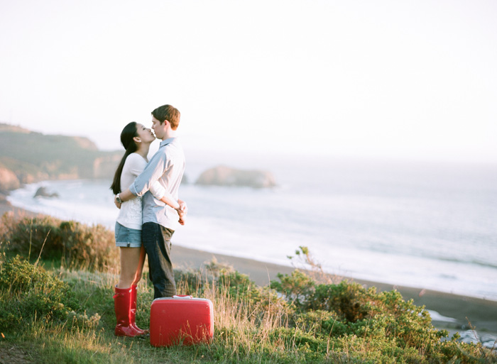 Sylvie-Gil-Engagement-Film-Photography-couple-red-rainboots-suitcase-vintage-kiss.jpg