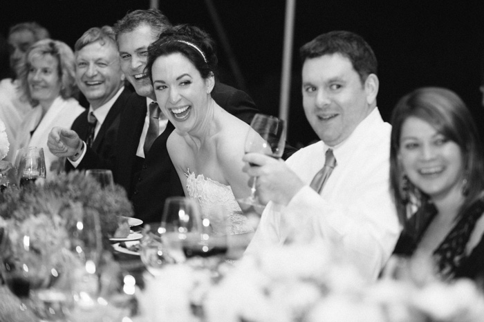 The newlyweds were all smiles at the dinner table, surrounded by their friends and family.