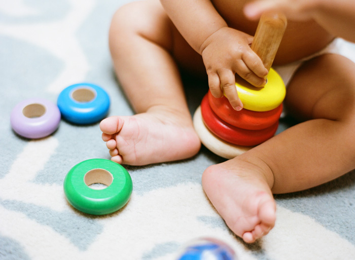 Sylvie-Gil-Family-Photography-baby-boy-toys-rings-feet-hands.jpg