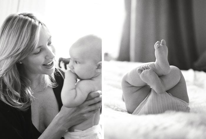 Sylvie-Gil-Family-Photography-baby-girl-mom-mother-hold-feet-diaper-black-white.jpg