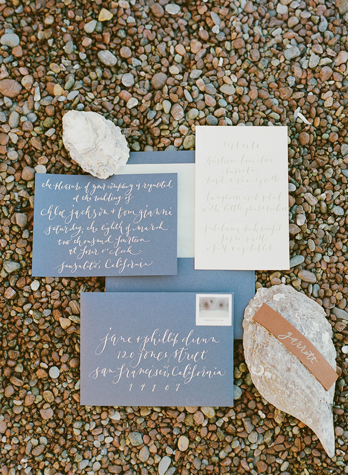 Grey-blue Invitation suite with shells on the beach; Sylvie Gil Photography