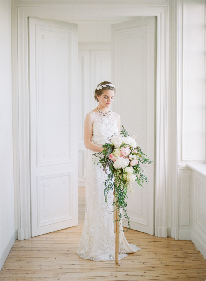 Bride with cascading pastel peony and vine bouquet; Sylvie Gil Photography
