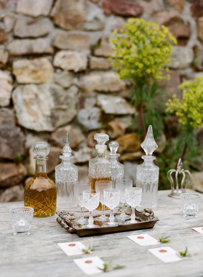 Wedding reception liquor tray with crystal decanters and glasses;  Sylvie Gil Photography