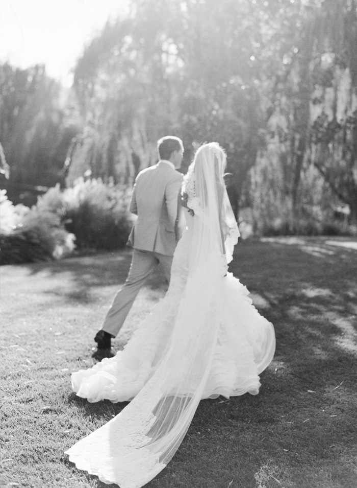 SylvieGIl_Film_Wedding_Photography_Black_Swan_Lake_Napa-Sonoma-California-Wedding-Dress-Groom-Walking