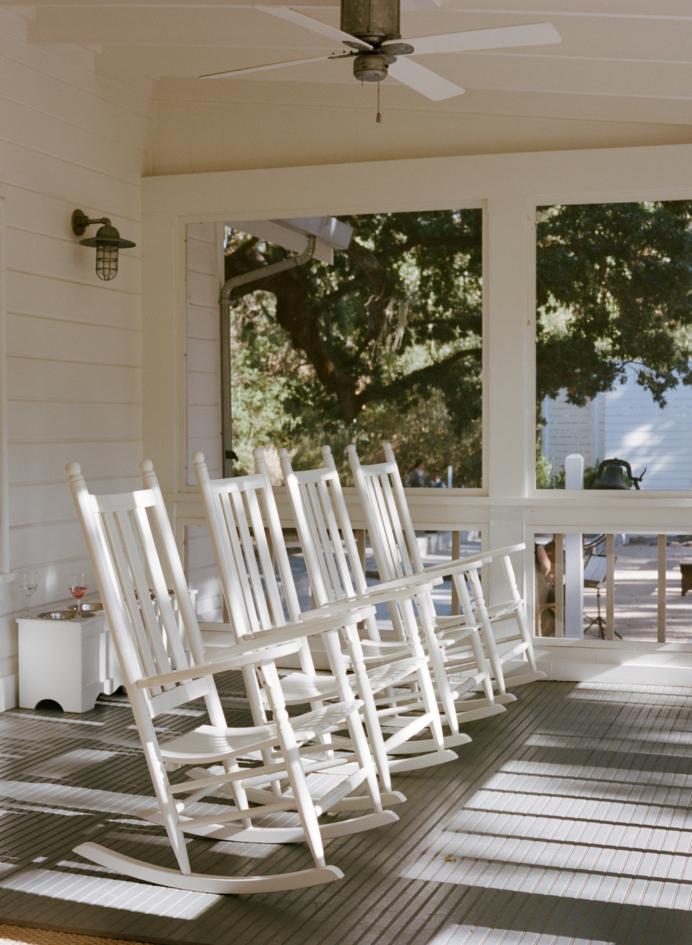 Charming white rocking chairs on ranch porch; Sylvie Gil Photography