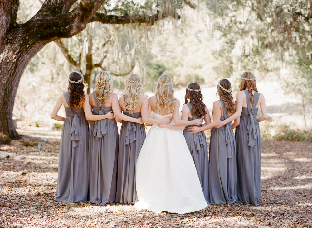 Bride and bridesmaids with curled hair and flower crowns; Sylvie Gil Photography