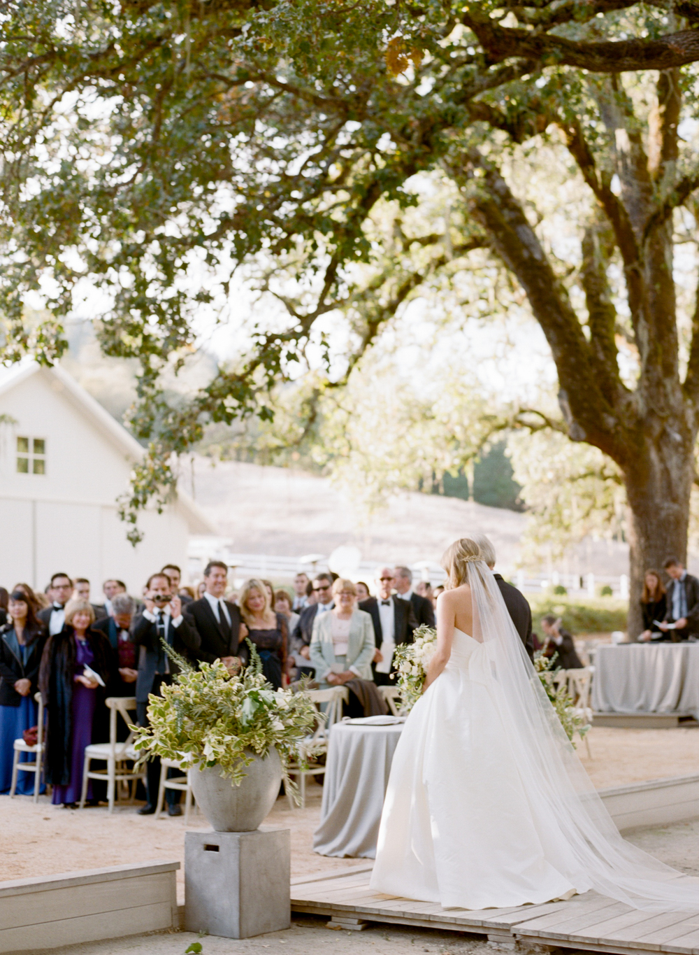 Father of the bride walks bride down aisle; Sylvie Gil Photography