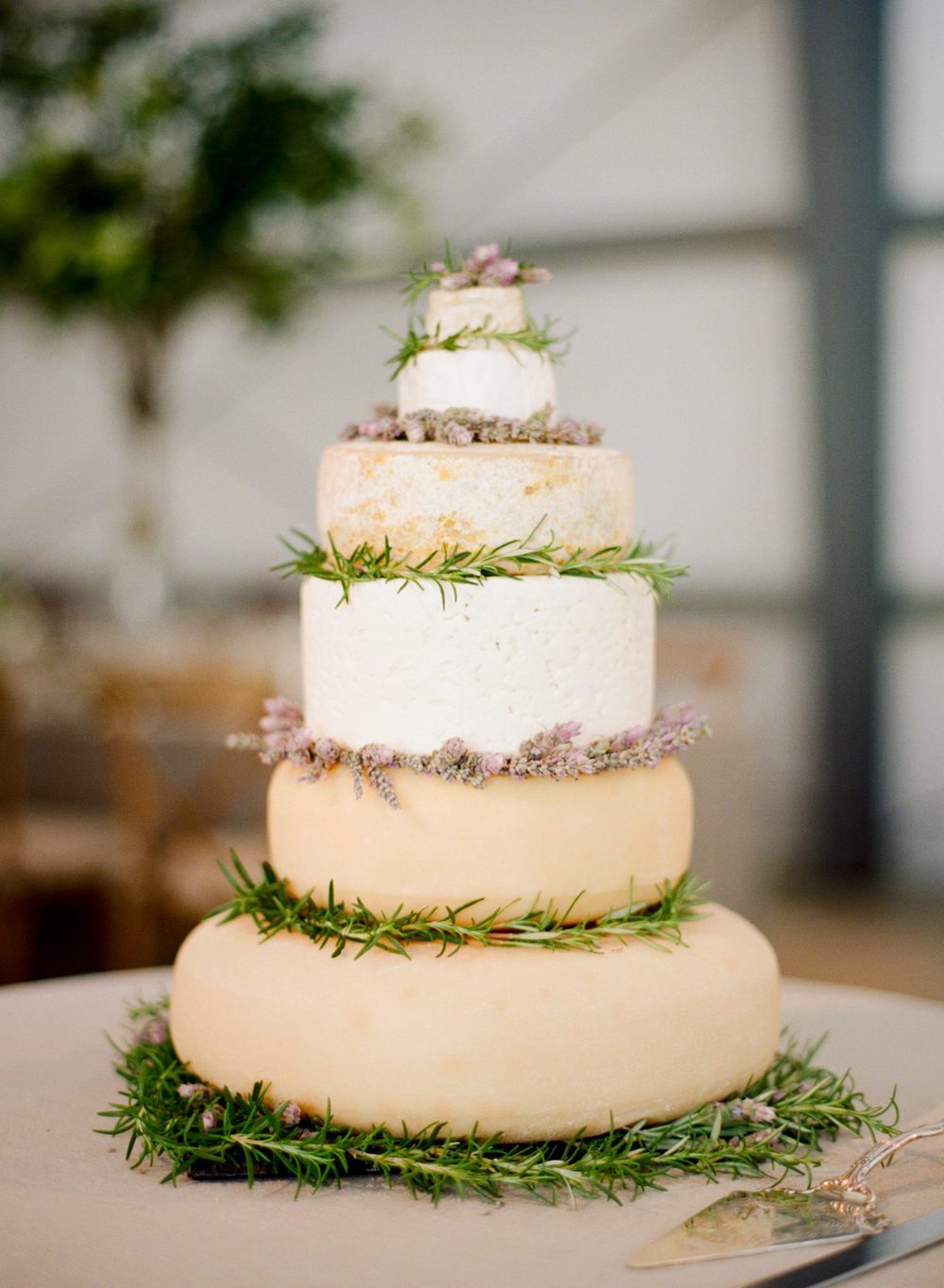 "Stacked rounds of cheese ""wedding cake"";  Sylvie Gil Photography"