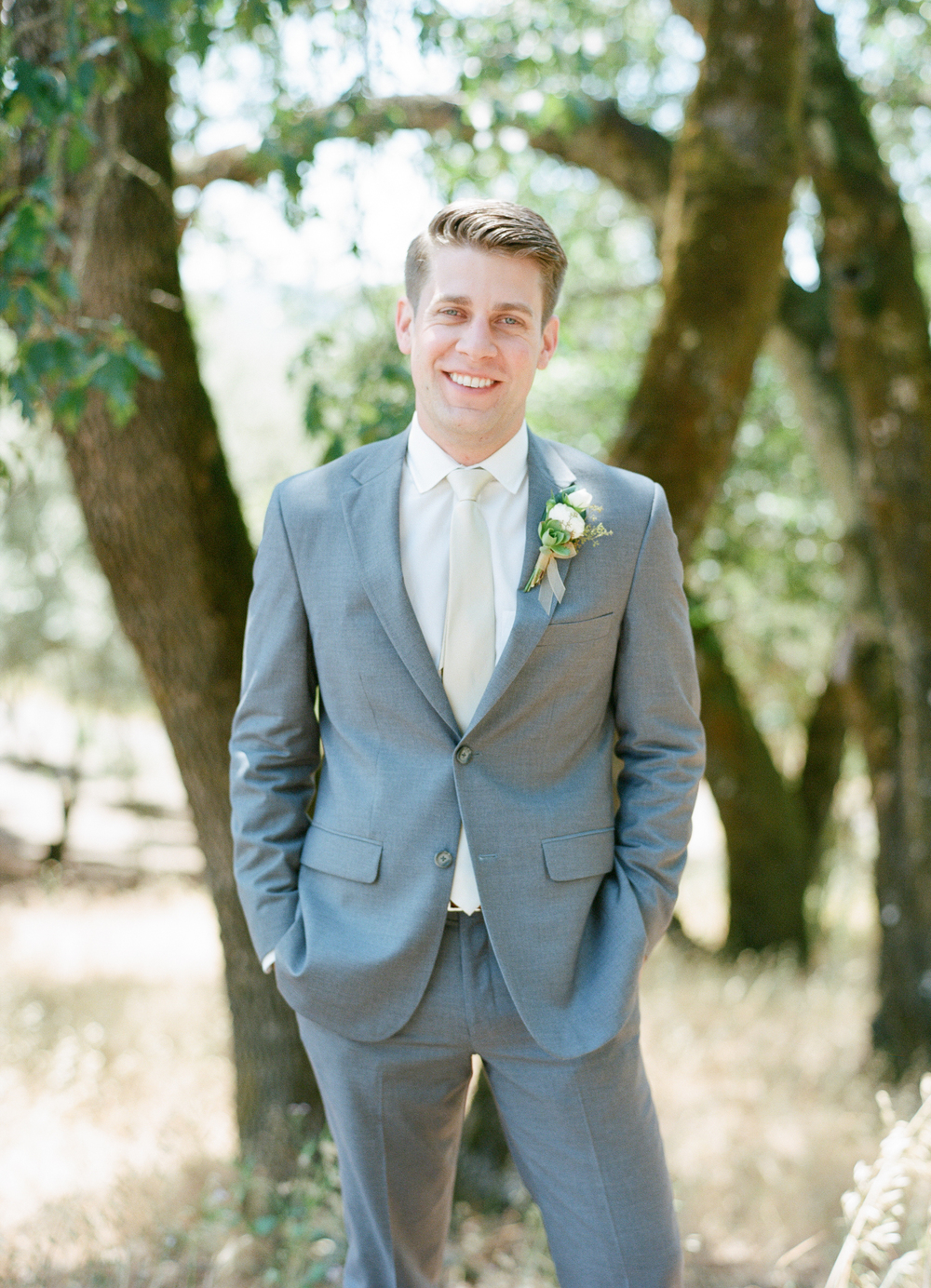 Sylvie-Gil-film-destination-photography-Kunde-winery-Napa-Valley-elegant-shabby-chic-groom-grey-suit-boutonniere