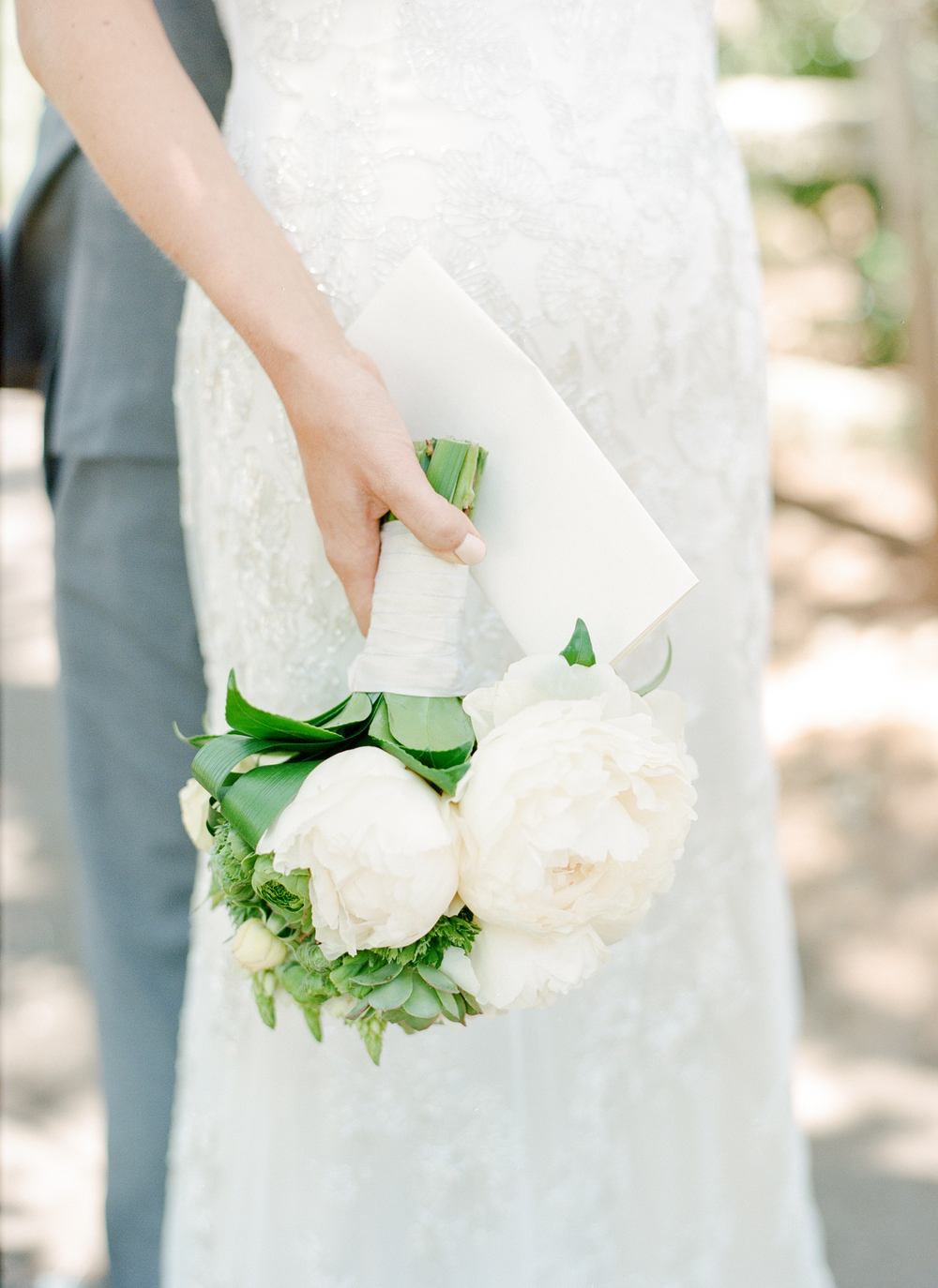 Sylvie-Gil-film-destination-photography-Kunde-winery-Napa-Valley-elegant-shabby-chic-bride-bouquet-first-look-letter