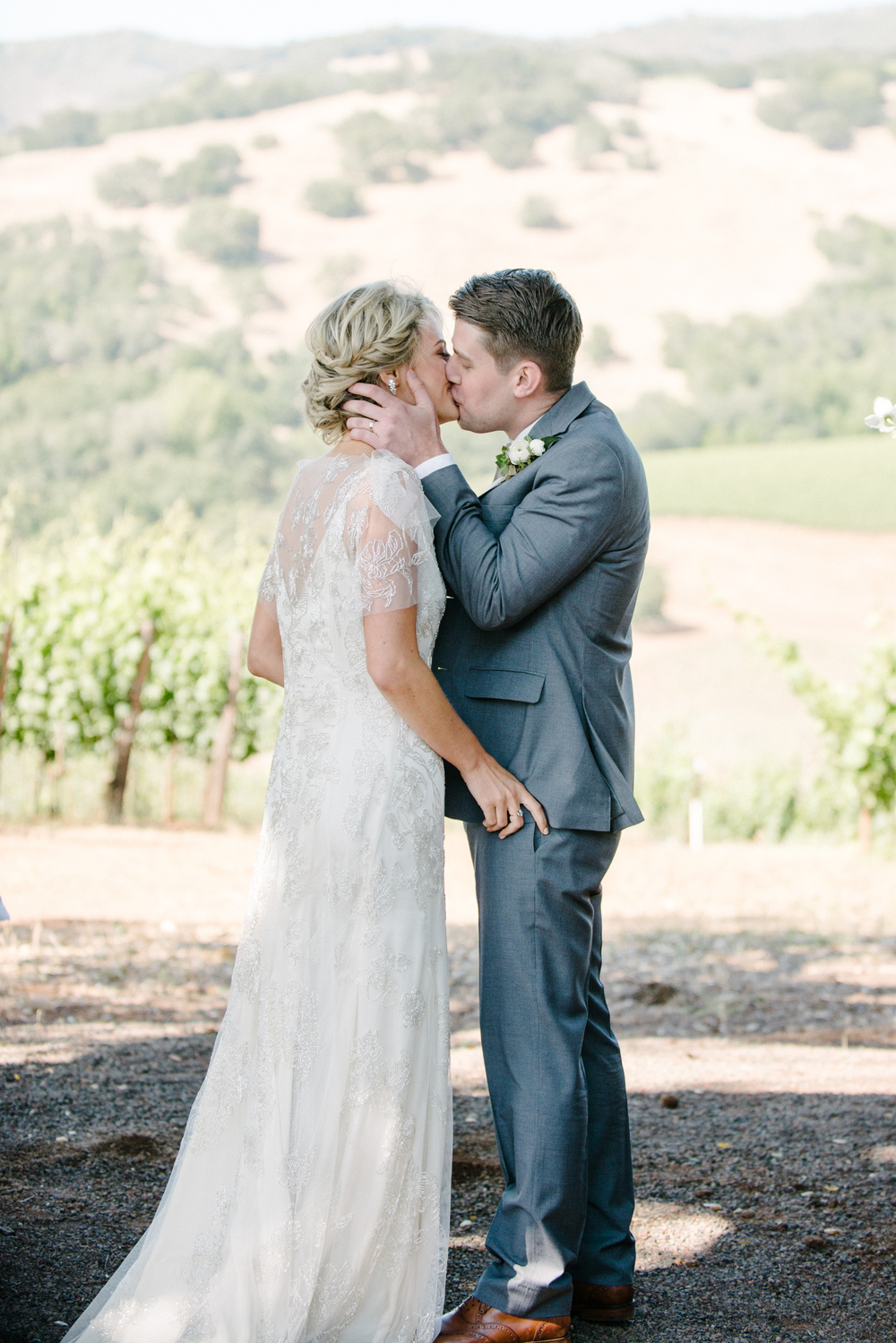 Sylvie-Gil-film-destination-photography-Kunde-winery-Napa-Valley-elegant-shabby-chic-bride-groom-kiss-ceremony