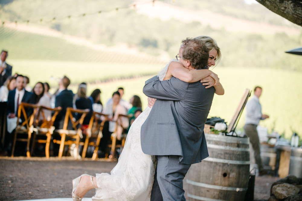 Sylvie-Gil-film-destination-photography-Kunde-winery-Napa-Valley-elegant-shabby-chic-bride-father-dance-jump