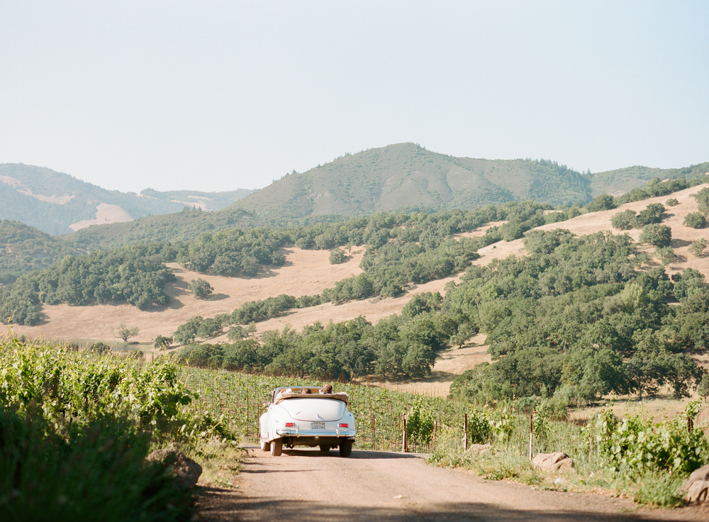 Sylvie-Gil-film-destination-photography-Kunde-winery-Napa-Valley-elegant-shabby-chic-vintage-white-convertible-car-vineyard