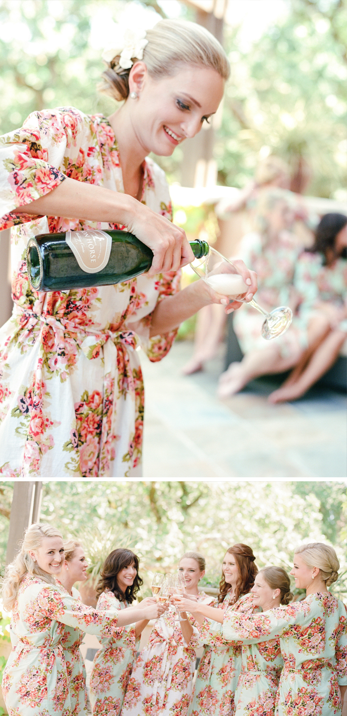 The glowing bride pours champagne for her bridesmaids, the group toasts to Caroline's happy day; photo by Sylvie Gil