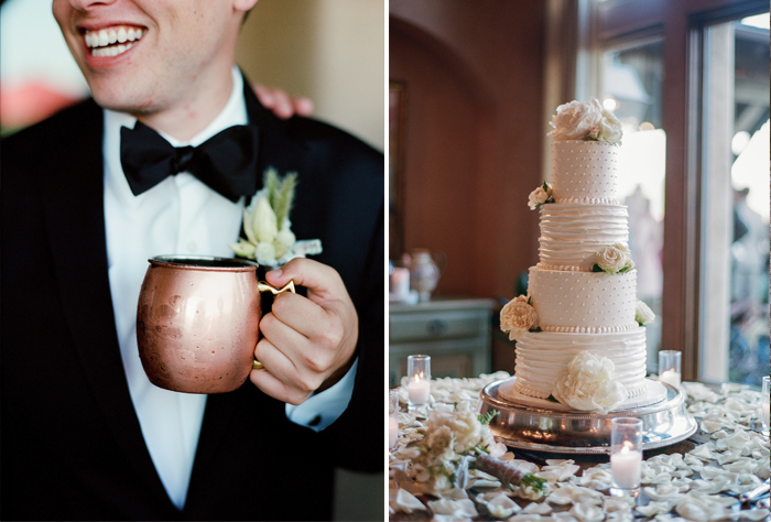 The elegant four-tiered wedding cake is garnished with roses and peonies; a groomsman holds a copper mug at the outdoor reception; photo by Sylvie Gil