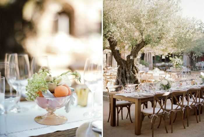 Table accents - a gilded bowl of apricots and kiwis sits on a dark wood table in the olive tree courtyard reception; photo by Sylvie Gil